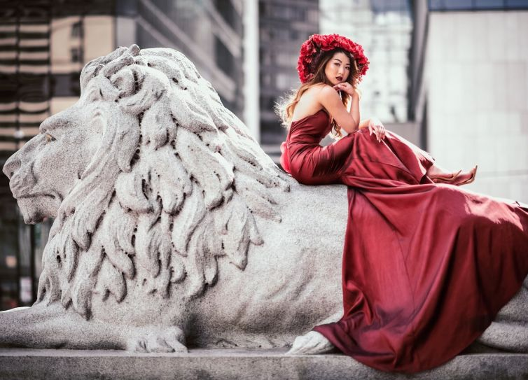woman-on-lion-statue